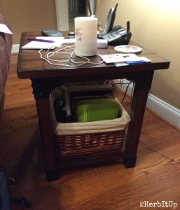 Placed neatly under a table, my Bible and planner basket is out of the way, but easily within reach.